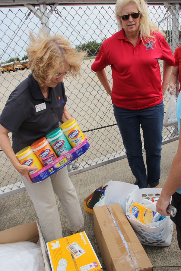 College of the Mainland employees donate supplies to the relief center in Dickinson. Pictured, Mary Ann Amelang, left, and Denese Angelle.